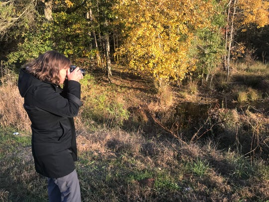 Shelley Robbins of Upstate Forever takes pictures to document changes at Kinder Morgan's 2014 Plantation Pipeline gasoline spill in Belton.