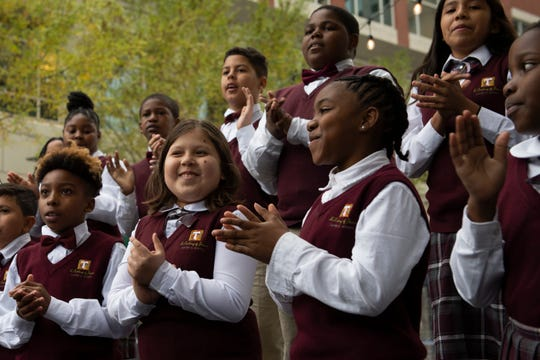 The choir from St. Anthony's of Padua perform during the opening ceremony for the United Community Bank Ice on Main Friday, Nov. 15, 2019.