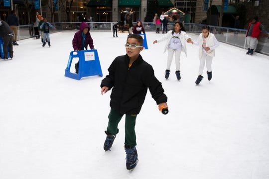 Skaters take to the ice after the opening ceremony for the United Community Bank Ice on Main Friday, Nov. 15, 2019.