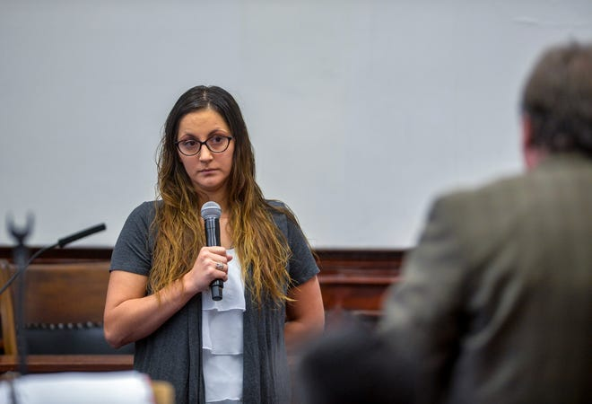 Katelyn Zdeb, the ex-wife of Brandon Craft, reviews evidence for the jury with deputy county attorney Kory Larson during the Craft homicide trial on Thursday in the Cascade County Courthouse. Brandon Craft is on trial for deliberate homicide in the 2016 shooting death of Adam Petzack.