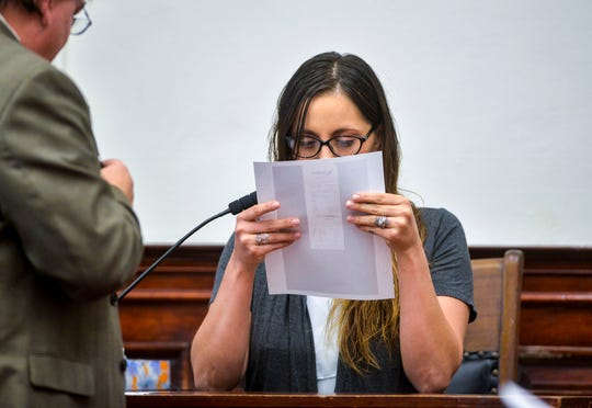 Katelyn Zdeb, the ex-wife of Brandon Craft, reads photo copied receipts for the court record during her testimony during the Craft homicide trial on Thursday in the Cascade County Courthouse.  Brandon Craft is on trial for deliberate homicide in the 2016 shooting death of Adam Petzack.