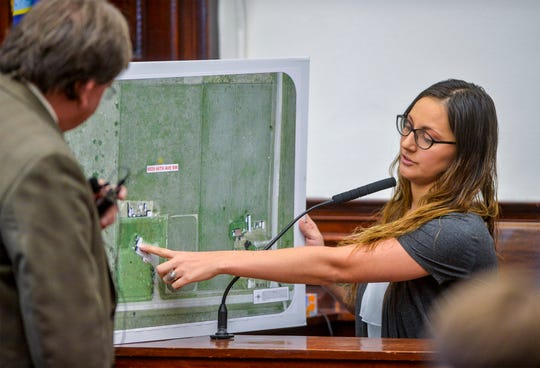 Katelyn Zdeb, the ex-wife of Brandon Craft, reviews evidence for the jury with Deputy County Attorney Kory Larson during the Craft homicide trial.