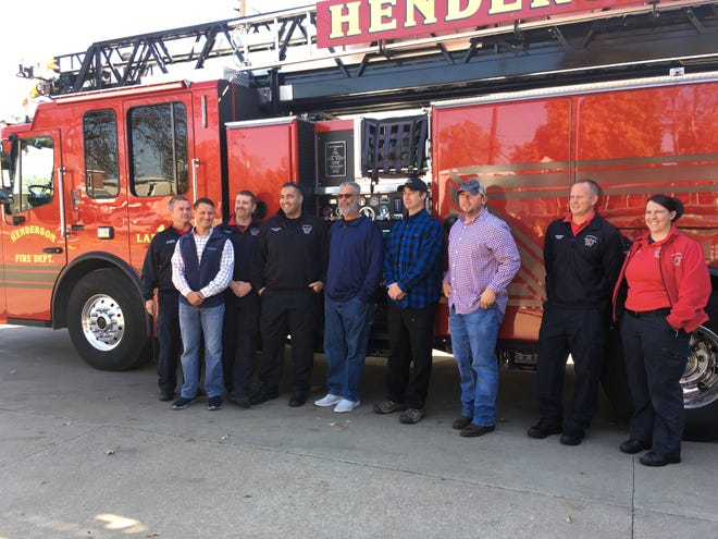 Jeremy Todd is pictured with the aerial truck and rescue crew on Nov. 10 at Henderson Fire Station One.
