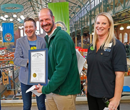 Indiana Recycling Coalition, the City of Indianapolis, and KIBI talk about recycling initiatives and teach people how to recycle, at the City Market, Friday, Nov. 15, 2019. Deputy Mayor Jeff Bennett, from left, Keep Indianapolis Beautiful CEO Jeremy Kranowitz, and Indiana Recycling Coalition Executive Director Allyson Mitchell enjoy the America Recycles Day proclamation given from the City of Indianapolis, during the event.