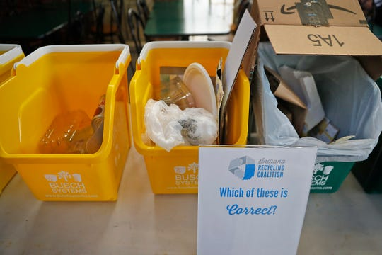 Indiana Recycling Coalition set up a display to teach about what goes in recycling and what does not, as Indiana Recycling Coalition joins the City of Indianapolis, and KIBI to talk about recycling initiatives and teach people how to recycle, at the City Market, Friday, Nov. 15, 2019.