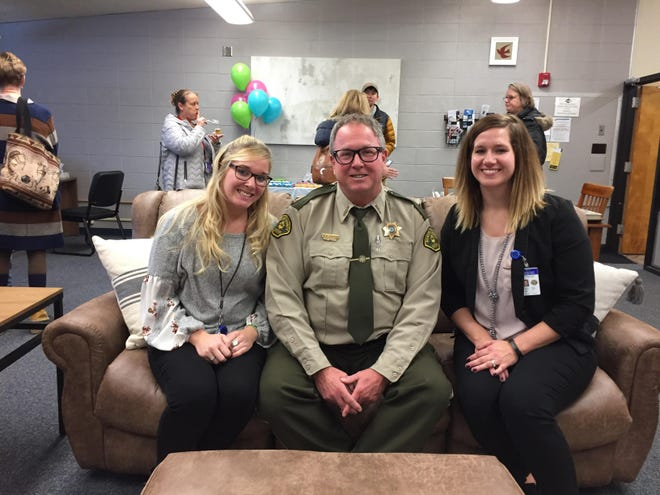 Law enforcement liaison Shelby Janes, Benton County sheriff Ronald Tippett, and Rural Access Center manager Lindsey Upah kindly pose for a picture at the Rural Access Center's open house in November of 2019.
