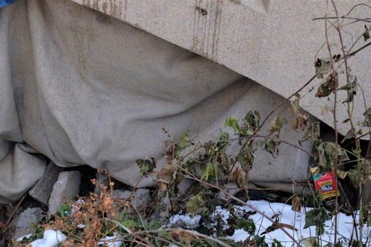 Under a foot bridge, a few feet from the waters of Ralston Creek, sheets of carpet and canvas shield and encampment from the wind chill on Friday, November 15, 2019 near Gilbert St.