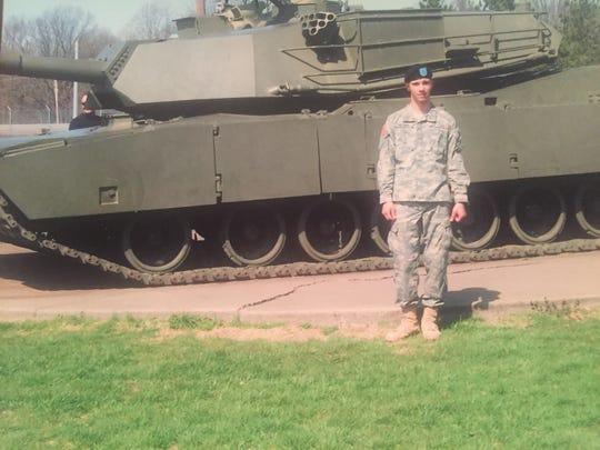 Army Specialist Brandon Freeman prior to his brain injury .