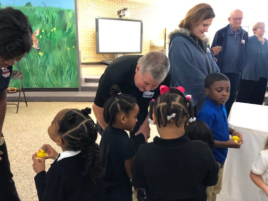 Madison County Imagination Library board member Bob Alvey talks with some of the students at Nova Early Learning Center on Thursday.