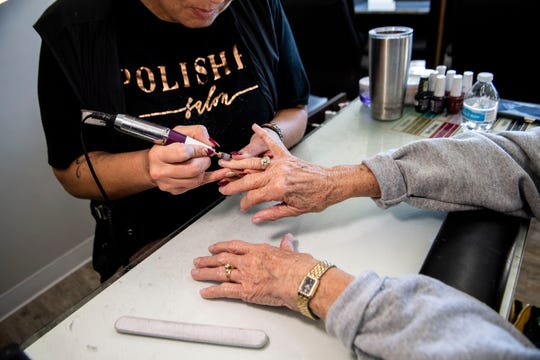 A woman gets her nails done at Polished's location at Thomsen Farms in Jackson, Tenn. on Nov. 21, 2019.