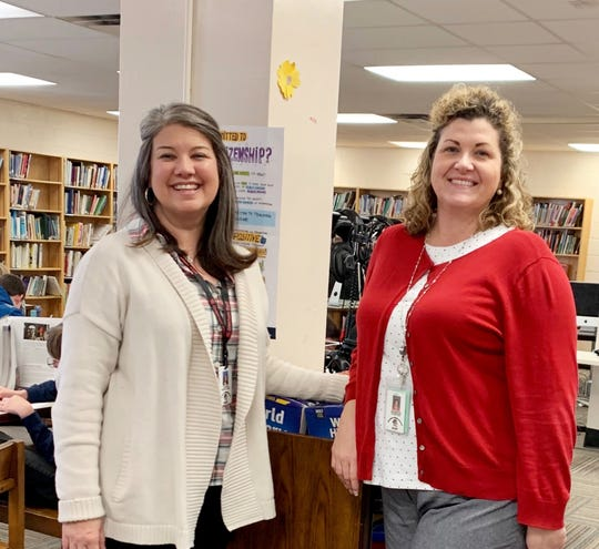 Librarian Jennifer Randolph with eighth grade school counselor Jennifer Pointer wearing their cardigans in support of World Kindness Day on Nov. 13, 2019 at Gresham Middle School.