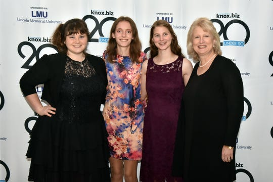 20 Under 20 honorees Kaitlyn Daniels, Ariane Hurt and Brianna Saylor pose for a photo with Lynne Fugate, CEO of the Girl Scout Council of Southern Appalachia, at the awards ceremony on Thursday, Nov. 14, 2019.