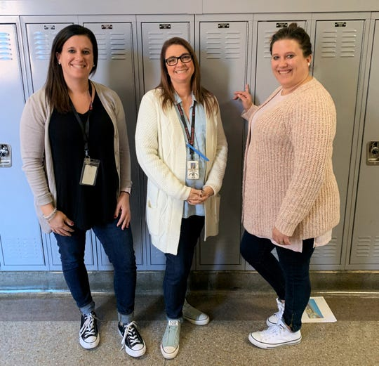 Gresham Middle School teachers Lindsey Clark, Nicole Resmondo and Heather Lynch wearing their cardigans in support of World Kindness Day on Nov. 13, 2019 at Gresham Middle School.