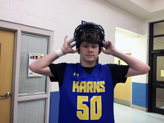 Matthew Eldridge, 13, represents the football team at a Showcase held at Karns Middle School Tuesday, Nov. 12.