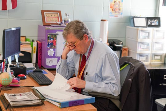 U.S. Sen. John Kennedy reviews lesson plans before he substitute teaches Friday a sixth-grade gifted social studies class at Paul Breaux Middle School.