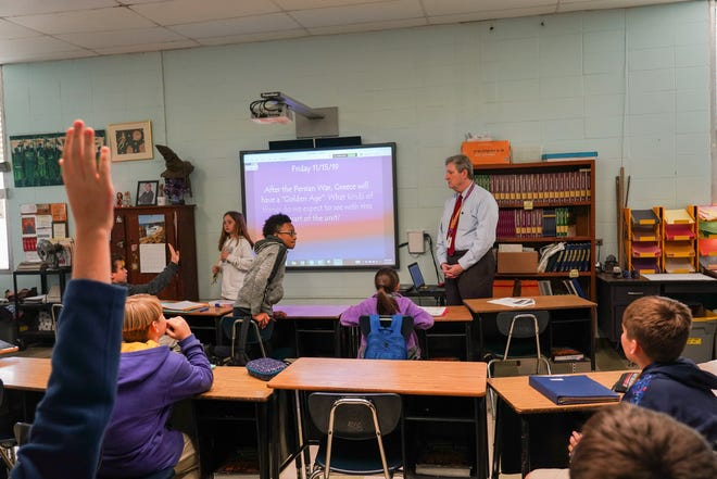 U.S. Sen. John Kennedy substitute teaches Friday in a sixth-grade gifted social studies class at Paul Breaux Middle School.