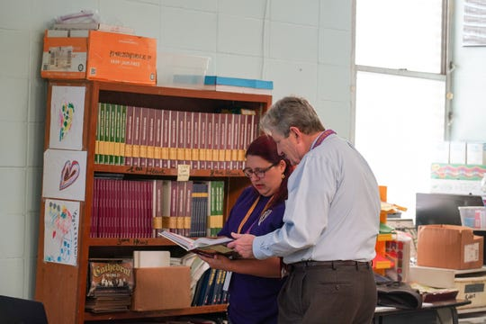 U.S. Sen. John Kennedy talks with Paul Breaux Middle School teacher Andrienne Tidwell before he substitute teaches Friday her sixth-grade gifted social studies class.