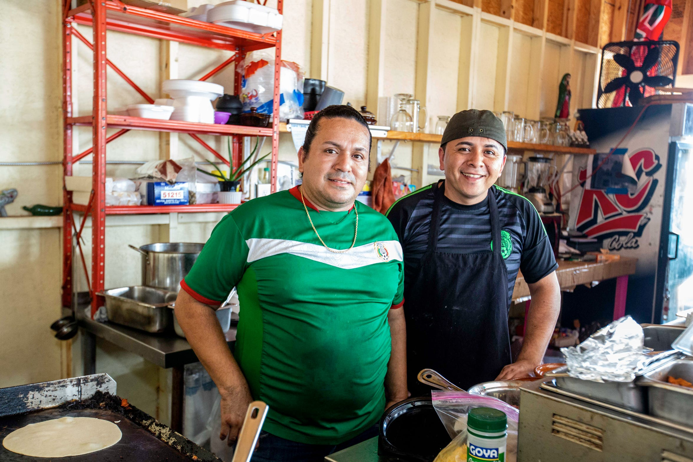 Ivan Castillo (left) and Gilberto Flores (right), life partners and co-owners of Garibaldi Antojitos Mexicanos, one of the first food businesses to open at the West Bank Flea Market.