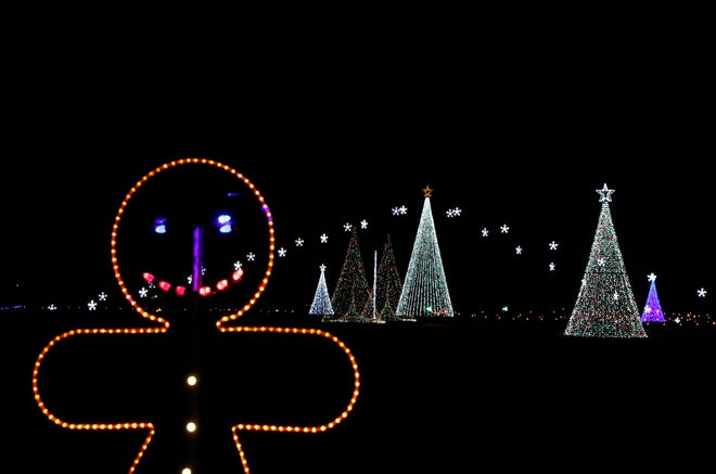 """Hundreds of thousands of lights in the """"WonderLight's Christmas in Ohio"""" holiday display illuminate National Trail Raceway in Hebron. The two-mile long display, which organizers say is one of the largest in the state, opens Nov. 13."""