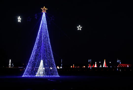 """Hundreds of thousands of lights in the """"WonderLights's Christmas in Ohio"""" holiday display illuminate National Trail Raceway in Hebron. The two-mile long display, which organizers say is one of the largest in the state, opens Nov. 15 and runs until Jan. 5."""