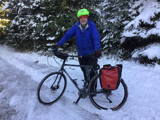 Bill Saint-Onge has his bicycle packed with gear and ready to go for his upcoming around-the-world trek, Tuesday, Nov. 13, 2019.