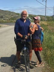 Bill Saint-Onge and Diane Goettlicher take a break from bicycling in Newfoundland in 2018. She will join him for part of his upcoming ride around the world.