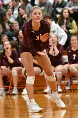 Paige Gallentine encourages her Charyl Stockwell teammates during a regional volleyball championship match against Monroe St. Mary on Thursday, Nov. 14, 2019.