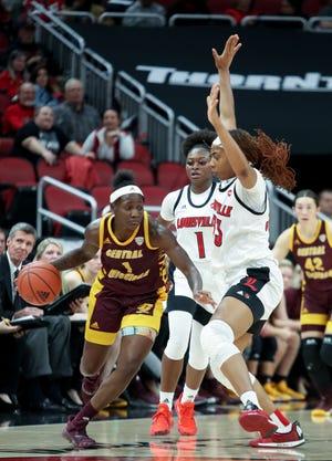 Louisville's Dana Evans and Bionca Dunham put pressure on Central Michigan's Micaela Kelly on Nov. 14, 2019