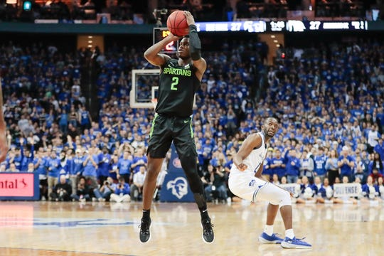 Nov 14, 2019; Newark, NJ, USA; Michigan State Spartans guard Rocket Watts (2) shoots the ball in front of Seton Hall Pirates guard Quincy McKnight (0) during the first half at Prudential Center. Mandatory Credit: Vincent Carchietta-USA TODAY Sports