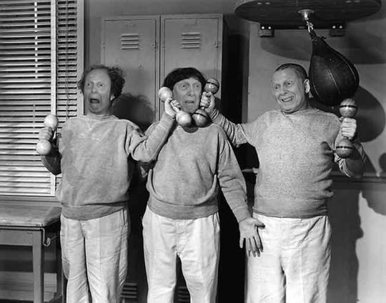 "Monty Engelman, 89, portrays Larry, Moe and Curly in the ""Three Stooges,"" a scene in the 2020 calendar by Burcham Hills residents."