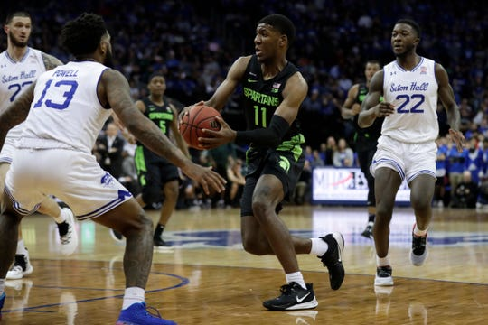 Michigan State forward Aaron Henry (11) drives to the basket past Seton Hall guard Myles Powell (13) during the first half of an NCAA college basketball game Thursday, Nov. 14, 2019, in Newark, N.J. Michigan State won 76-73. (AP Photo/Adam Hunger)