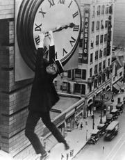 "Bruce Greenman, 98, is Harold Lloyd, taken from a 1923 silent film, ""Safety First!"" The scene is used in a 2020 calendar created by Burcham Hills residents."