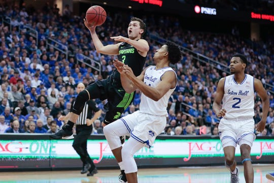 Nov 14, 2019; Newark, NJ, USA; Michigan State Spartans guard Foster Loyer (3) shoots the ball as Seton Hall Pirates guard Jared Rhoden (14) defends during the first half at Prudential Center. Mandatory Credit: Vincent Carchietta-USA TODAY Sports