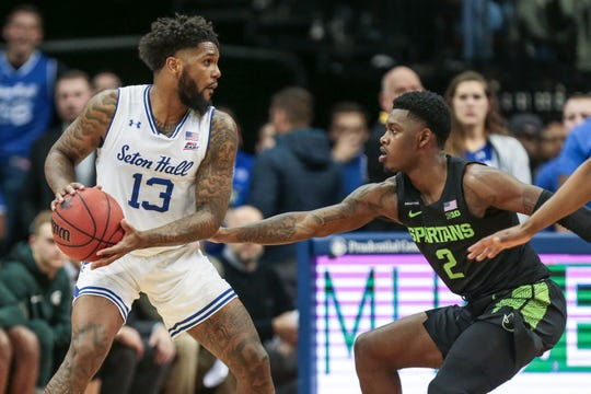 Nov 14, 2019; Newark, NJ, USA; Seton Hall Pirates guard Myles Powell (13) controls the ball as Michigan State Spartans guard Rocket Watts (2) defends during the first half at Prudential Center. Mandatory Credit: Vincent Carchietta-USA TODAY Sports