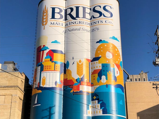 Briess Malt & Ingredients Co.'s new graphic design on its malting silos near Eighth and Washington streets in downtown Manitowoc. The vinyl wrap covers up the iconic Budweiser murals that were painted on the towers.