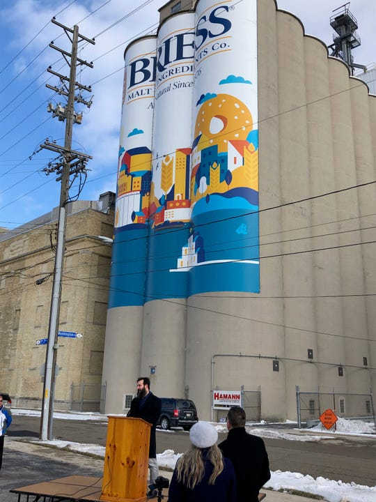 Craig Briess speaks at an event unveiling Briess Malt & Ingredients Co.'s new graphic design on its malting silos near Eighth and Washington streets in downtown Manitowoc on Nov. 14, 2019.