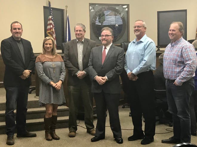 Kim Koratsky (center) was appointed as Lakeland's new municipal court judge at a board meeting on Thursday. Koratsky serves as the second judge in the city's history. He stands with commissioners Wesley Wright (far left), Michele Dial (left), Richard Gonzales Jr. (center left), mayor Mike Cunningham (right) and vice mayor Josh Roman (far right).