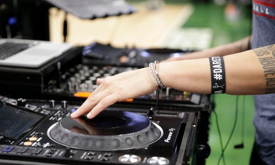 Every song and sound effect that plays in the arena at a Bucks game is produced DJ Shawna.