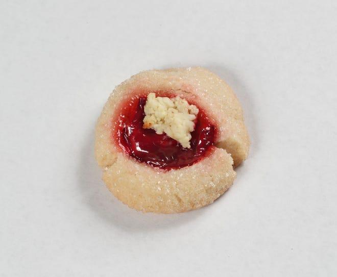 Chapeaux de Noel thumbprints are a two-bite twist on cherry cheesecake.