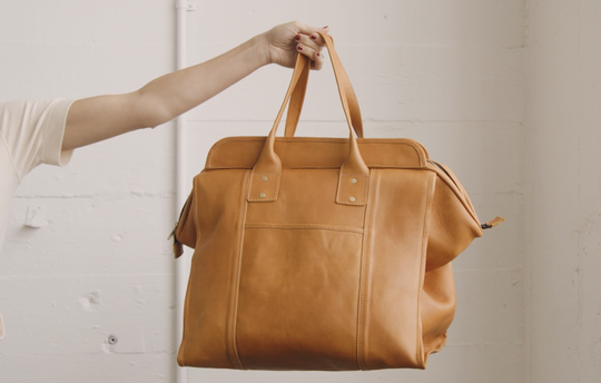 The Weekender by Prim & Clove is made of heirloom-quality leather with a wipeable interior and solid, natural brass hardware.It retails for $450.