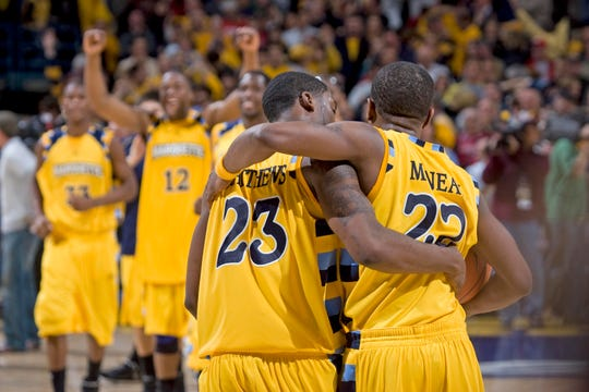 Marquette's Wesley Matthews and Jerel mcNeal celebrates their 61-58 win over UW-Madison at the Bradley Center in Milwaukee Friday, Dec. 6, 2008.