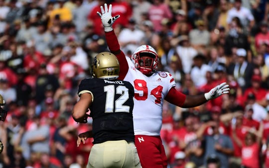 Nebraska defensive lineman Khalil Davis pressures Colorado quarterback Steven Montez during a game last September.