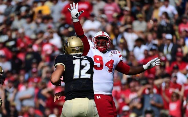 Nebraska defensive lineman Khalil Davis pressures Colorado quarterback Steven Montez during a game last September.