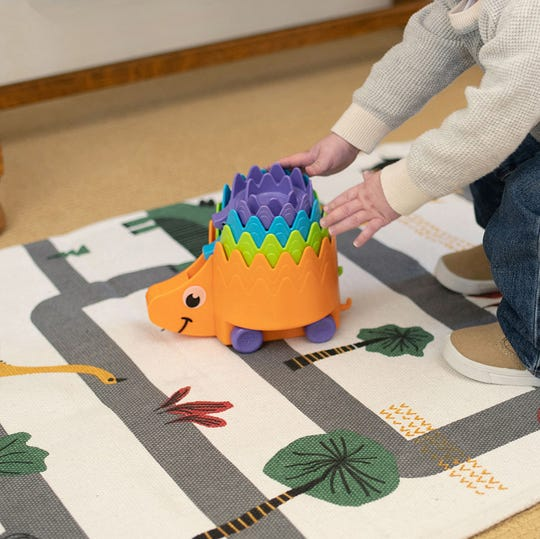 Hiding Hedgehogs is a stacking toy for toddlers. It's recommended by Ruckus and Glee toy store in Wauwatosa.