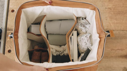 """The interior of The Weekender by Prim & Clove has five structured sections and two zipper pockets to give """"organization and function to keep packing as much as you need without adding bulk,"""" said founder and designer Lisa Boettcher. There are also two exterior pockets."""