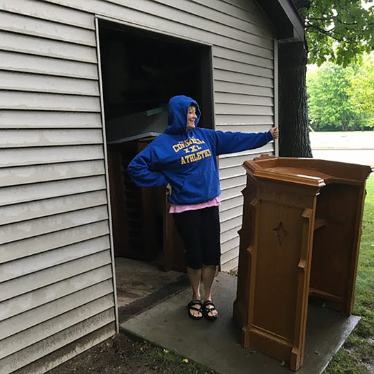 Two years ago, Donna Bourget and her kids traveled to Cornell, near Eau Claire, to pick up the pulpit and altars from a storage building.