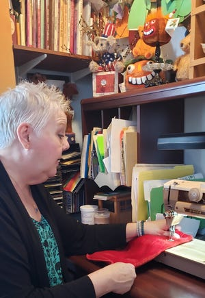 Amy Thornton, a longtime teddy bear artist, shows her grandmother's sewing machine in her New Berlin home on Nov. 15. Thornton created a special Skywalker bear for Kaden's Wish, an annual fundraiser to raise money for Make-A-Wish.