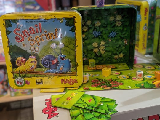 Snail Sprint is a racing game played with dice, cards and snail pieces that can climb up the sides of the magnetic box. It's recommended by The Board Game Barrister.