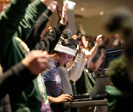 Shawna Nicols, DJ Shawna plays music from the Clutch Crew section of Fiserv Forum during a Bucks game.