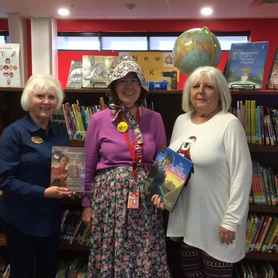 The Caroline Meriwether Goodlett Chapter #2644 of the United Daughters of the Confederacy® recently donated books on the War Between the States to the Flippin Elementary and Middle School Library. Pictured are: (from left) Dianne Freeman, UDC President; Suzie Rook, Flippin librarian; and Judith Lawrence, UDC Chapter Publicity Chairman.